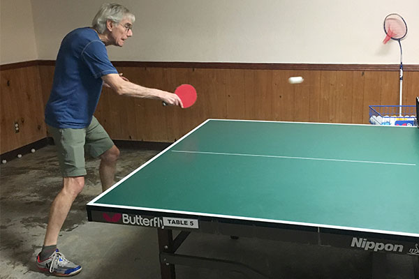 Man practicing table tennis