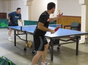 Two men playing ping pong on table 1