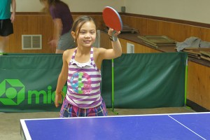 Young girl with table tennis paddle
