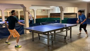 Wireless & Scotty playing table tennis