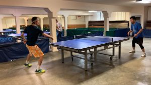 two men playing table tennis (Wireless & Scotty)